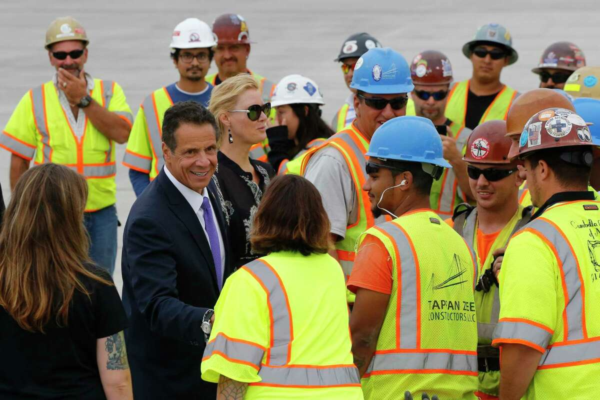 New York Gov. Andrew Cuomo meets with construction workers during the official opening of the Gov. Mario M. Cuomo Bridge, Friday, Sept. 7, 2018, in Nyack, N.Y. The bridge linking Westchester and Rockland counties over the Hudson River replaces the old Tappan Zee Bridge, most of which has been demolished. The new bridge's first span opened last year, when the structure was named to honor Mario Cuomo, New York's governor from 1983 to 1994 and father of the state's current chief executive, Andrew Cuomo. (AP Photo/Mark Lennihan)
