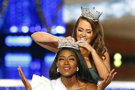 Miss New York Nia Franklin reacts after being named Miss America 2019, by last year's winner Cara Mund, Sunday, Sept. 9, 2018, in Atlantic City, N.J. (AP Photo/Noah K. Murray)
