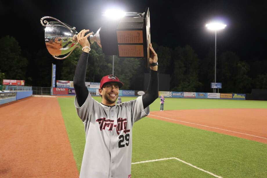 ValleyCats manager Jason Bell celebrates with the trophy after winning the New York-Penn League championship Sunday. (Chris Chenes/Tri-City ValleyCats Baseball)