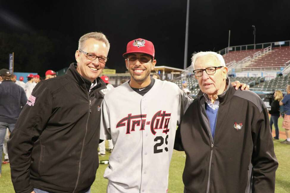 Rick Murphy, COO, left, manager Jason Bell, and Bill Gladstone, President / Principal Owner, right, celebrate the ValleyCats winning the New York-Penn League championship. (Chris Chenes / Tri-City ValleyCats Baseball)