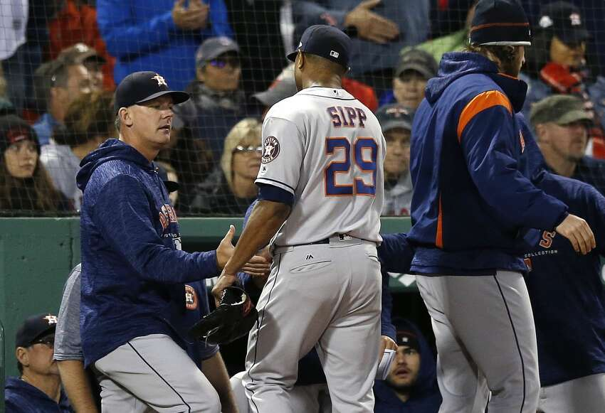 Houston Astros' Tony Sipp enters the dugout after pitching during the eighth inning of a baseball game against the Boston Red Sox in Boston, Sunday, Sept. 9, 2018. (AP Photo/Michael Dwyer)