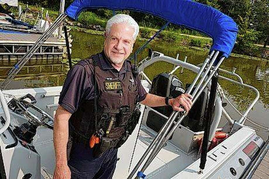 Senior Deputy Steve Wernikoff is one of the officers with the Lake County Sheriff Marine Unit who saved a person from drowning. Senior administrative assistant Ryan McCormack was the other. Photo: Paul Valade | Daily Herald (AP)