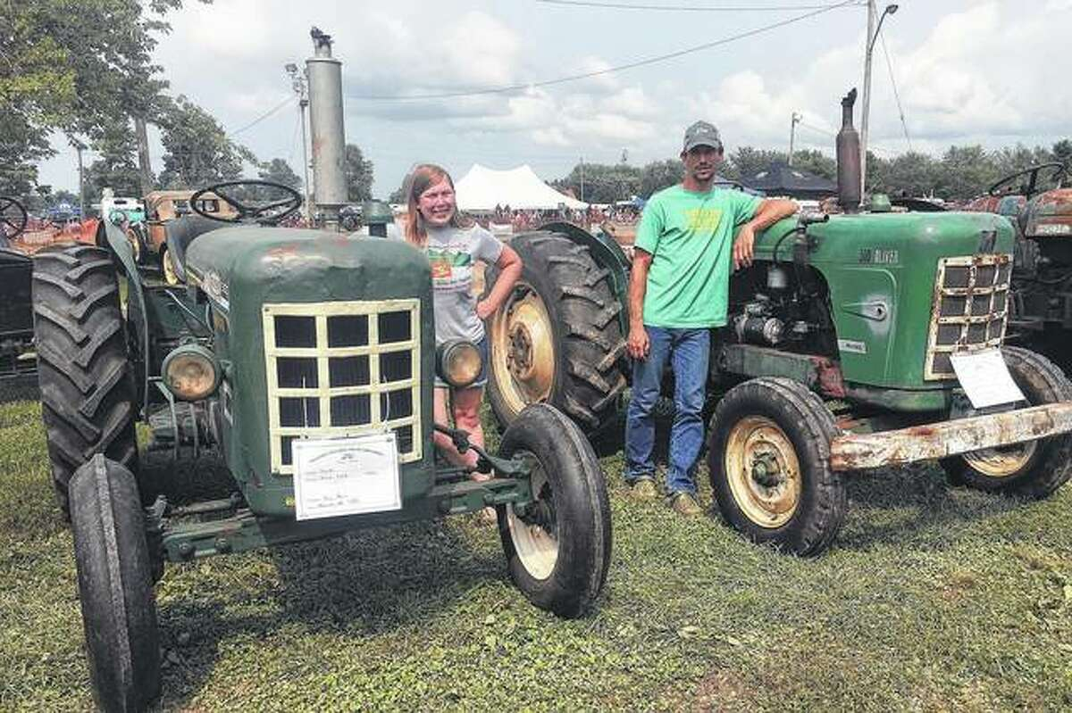Joy Harris of rural Alexander (left) and Adam Wallace of rural Girard were invited to bring their Oliver 500 tractors to the second gathering of the machines in Canada.
