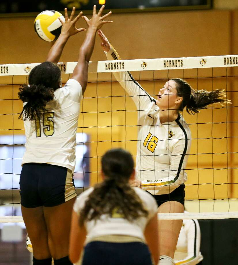 East Central's Cheyenne Dantonio (right) tries to hit the ball past Holy Cross' Mackenzie Vernon during their high school volleyball match at East Central on Tuesday, Sept. 4, 2018. Photo: Marvin Pfeiffer, Staff / San Antonio Express-News / Express-News 2018