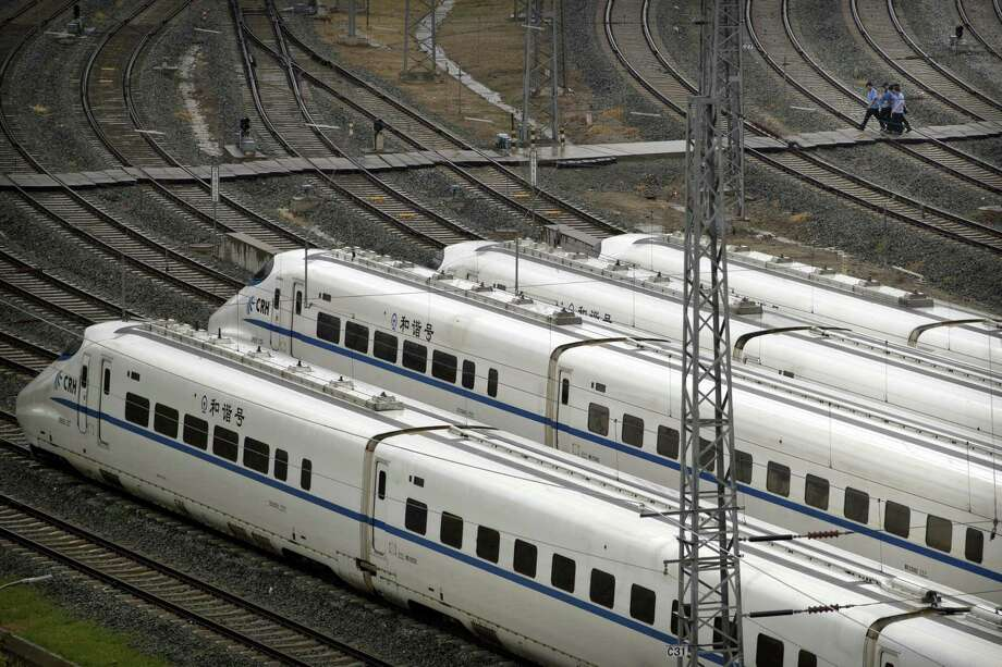 Workers walk past parked high-speed trains at a maintenance yard before the 2018 Forum on China-Africa Cooperation in Beijing. Chinese funds for infrastructure and investment projects like railroads have flooded into Africa in recent years, prompting warnings from the United States that the money comes with strings attached. Photo: Mark Schiefelbein / Associated Press / Copyright 2018 The Associated Press. All rights reserved