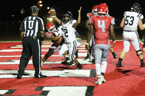 Liberty running back Jeremiah Guillory holds his hands up signaling a touchdown in the game's only time for either team to cross the goal line. The Panthers handed their neighbors to the north a 7-0 non-district loss.