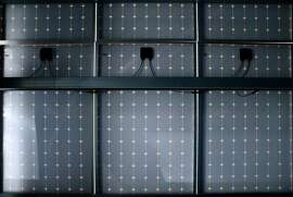 Solar panels for a microgrid power system are erected on the roof of a garage at the Kaiser Permanente Medical Center in Richmond, Calif. on Friday, Sept. 7, 2018. The system collects and stores up to one megawatt of energy in a network of 252 battery cells.