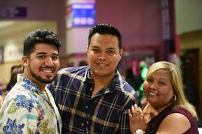 Paul Ortiz, Manuel Montes and Maria Montes pose for a photo before the Yuridia Concert.