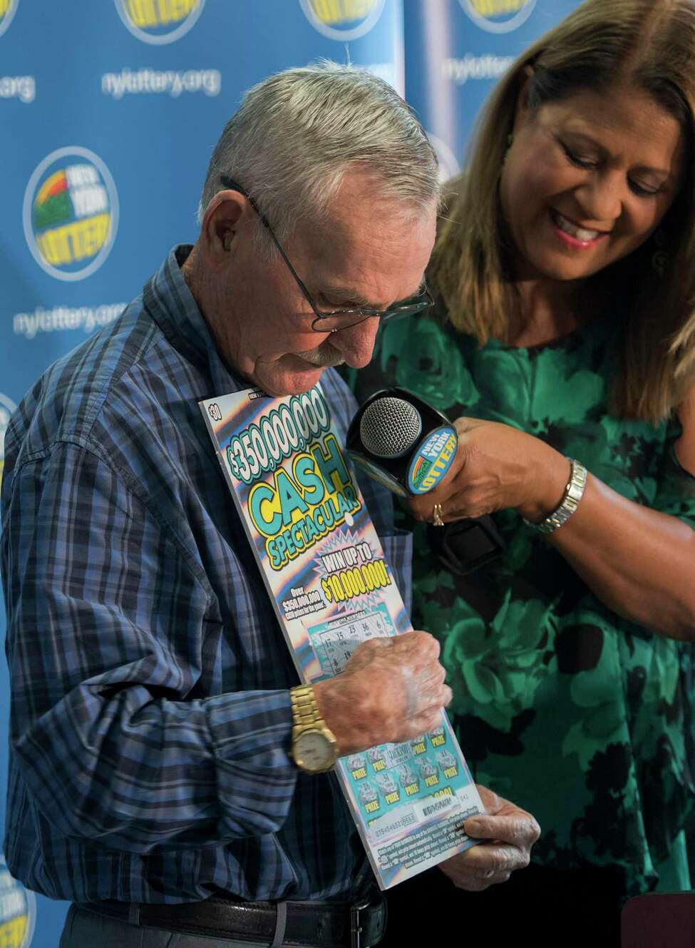 $10 million scratch off winner 73-year-old Dale Farrand of Fort Edward explains how he scratched off his card while being interviewed by New York Lottery's own Yolanda Vega at a press conference at the Lottery Headquarters Monday Sept. 10, 2018 in Schenectady, N.Y. (Skip Dickstein/Times Union)