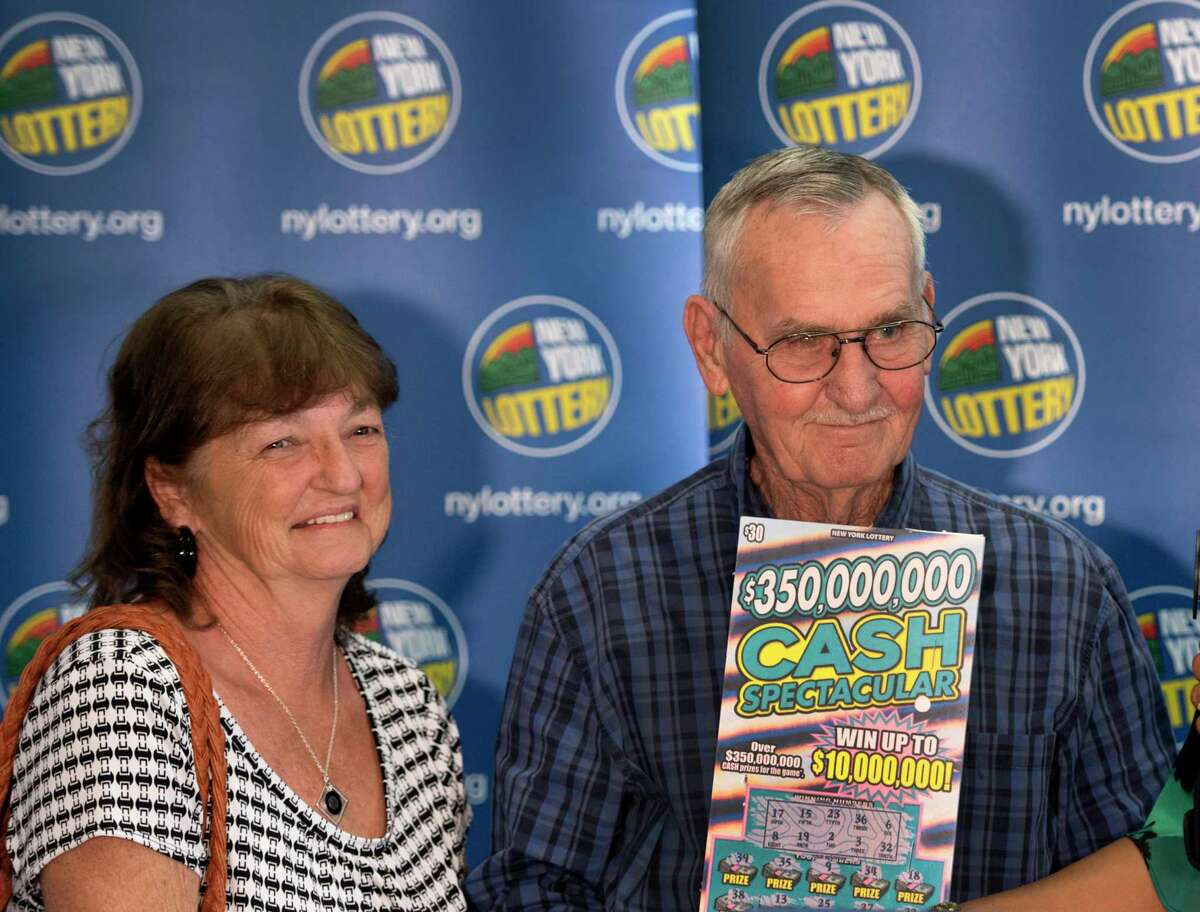 $10 million scratch off winner Seventy-three-year-old Dale Farrand of Fort Edward and wife Cathy are presented to the public at a press conference at the Lottery Headquarters Monday Sept. 10, 2018 in Schenectady, N.Y. (Skip Dickstein/Times Union)