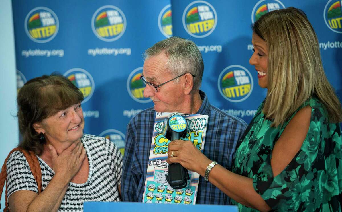 $10 million scratch off winner 73-year-old Dale Farrand of Fort Edward, center and wife, Cathy, left, are presented to the public by New York Lottery's own Yolanda Vega at a press conference at the Lottery Headquarters Monday Sept. 10, 2018 in Schenectady, N.Y. (Skip Dickstein/Times Union)