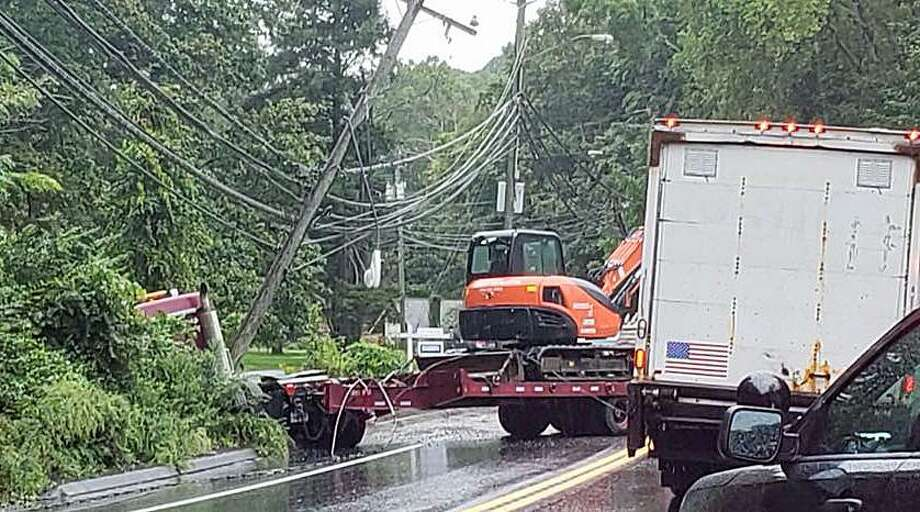 A truck hauling a trailer crashed into a utility pole on Danbury Road (Route 7) on Monday, Sept. 10, 2018. The crsash pulled down wires and forced police to close the road between Olmstead Hill Road and Route 107 so Eversource can make repairs. Photo: Wilton Police Department Photo