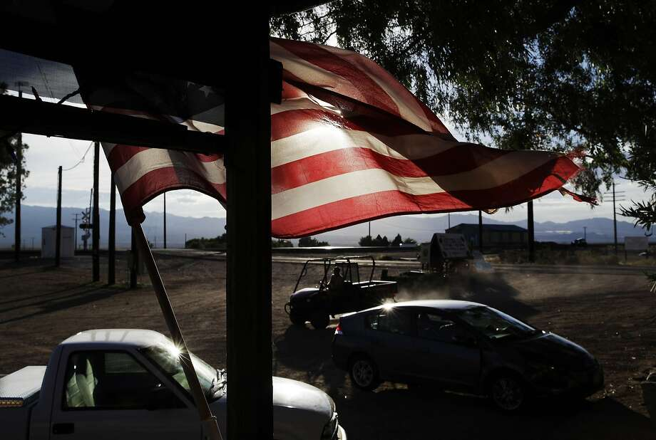 A flag flies in front of a store in Nipton (San Bernardino County). Photo: John Locher / AP