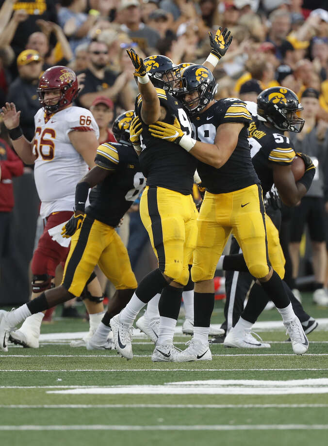 Iowa defensive end A.J. Epenesa, left, and Iowa defensive end Anthony Nelson, right, embrace after an Iowa fumble recovery during the second half of an NCAA college football game, Saturday, Sept. 8, 2018, in Iowa City, Iowa. Iowa won 13-3. Photo: Associated Press