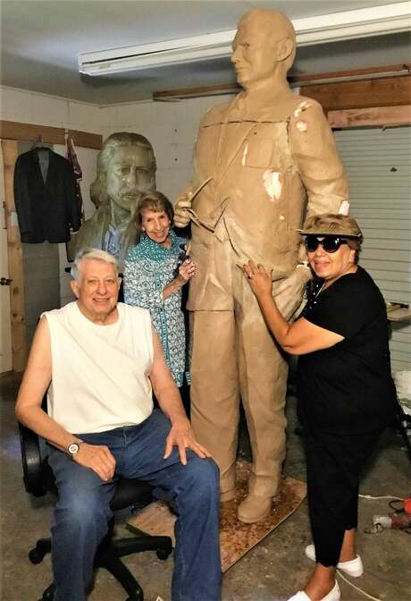Artist Bob Harness is seen here sitting with Hofheinz's widow Mary Frances Hofheinz (at center) at his studio in Carthage.  Photo: Donnie Pitchford
