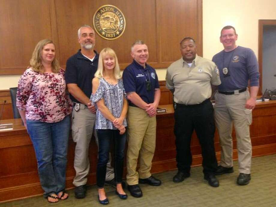 Members of the new, Alton Department of Code Enforcement team are: (left to right) Becky Brunaugh, Jeff Walker, Micky Jones, Supervisor Gary Cranmer, Pfc. Vince Warlick and Sam Shaw. Photo: Linda N. Weller | The Telegraph