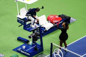 Serena Williams of the U.S. speaks with Carlos Ramos, the chair umpire, during the U.S. Open final against Naomi Osaka of Japan at Arthur Ashe Stadium in New York, Aug. 8, 2018. Ramos, who gave Williams three code-of-conduct violations in the match, has a record of taking on the sport's titans. (Karsten Moran/The New York Times)
