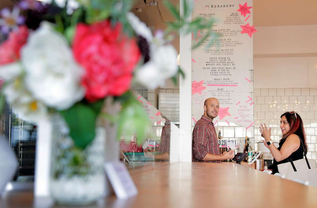 """Brian Crookes, co-owner, takes an order from a customer at The Kebabery restaurant in Oakland, Calif., on Wednesday, August 22, 2018. On Tuesday night, a restaurant inspector with the Alameda County Environmental Health Department potted Nokni, a two-year-old """"popup"""" run by Julya Shin and Steve Joo at The Kebabery, and now a supervisor at the health department is asserting that all pop-ups are illegal according to the California state food and beverage code."""