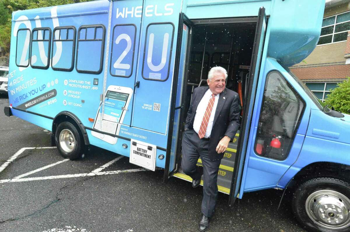 Norwalk Mayor Harry Rilling steps off one of the new graphic wrapped buses as the Norwalk Transit District introduces its new MicroTransit on demand buses Wheels2U. The buses were shown at the Norwalk Transit District headquarters on Monday September 10, 2018 in Norwalk Conn.