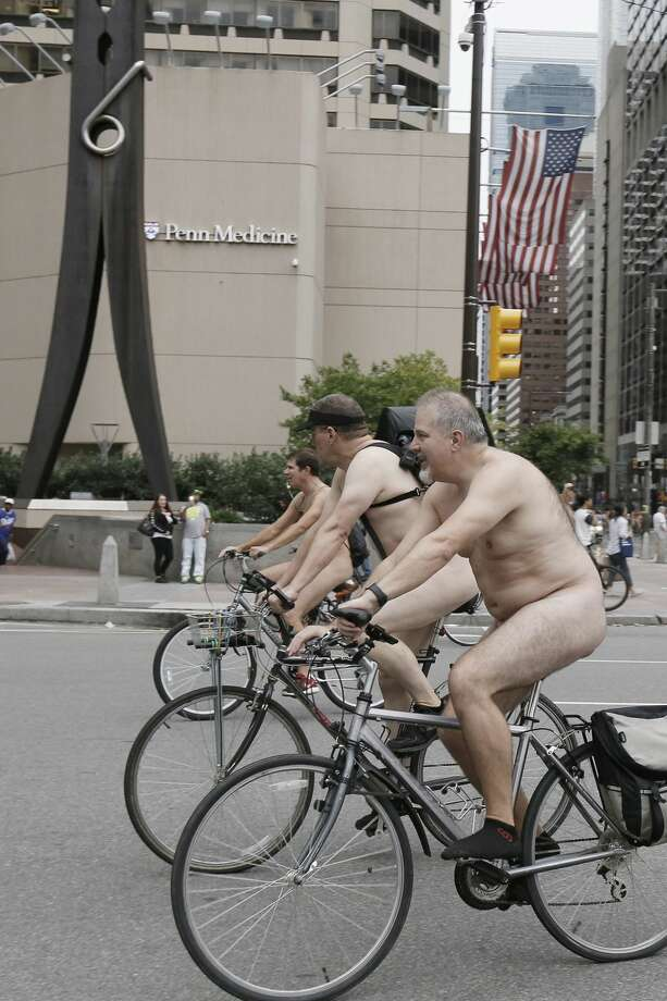 Bikers arrive at City Hall during the Philly Naked Bike Ride in Philadelphia on Saturday, Sept. 8, 2018. The event was organized to protest dependence on fossil fuels, advocate for the safety of cyclists on the road and promote positive body image. (Elizabeth Robertson/The Philadelphia Inquirer via AP) Photo: Elizabeth Robertson/Associated Press