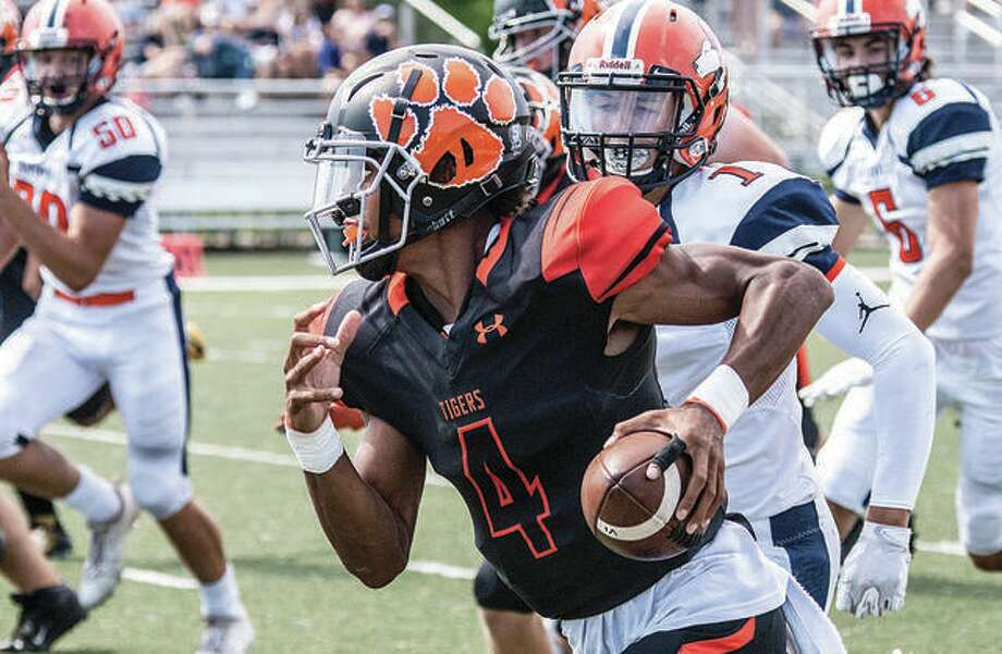 Edwardsville quarterback Kendall Abdur-Rahman (4) has committed to attend the University of Notre Dame. He is shown in action in last season's playoffs against Naperville North.