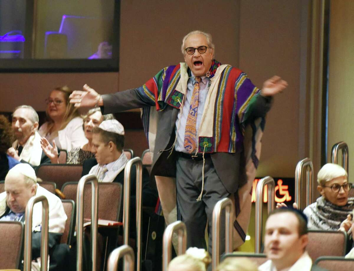 Temple Sholom Director of Education Barry Gruber dances to music during Temple Sholom's Rosh Hashanah Family Service at Greenwich High School's Performing Arts Center in Greenwich, Conn. Monday, Sept. 10, 2018. The celebration of the Jewish New Year was highlighted by interactive musical performances from Sheldon Low and sermons by Rabbi Chaya Bender and Rabbi Mitchell M. Hurvitz.