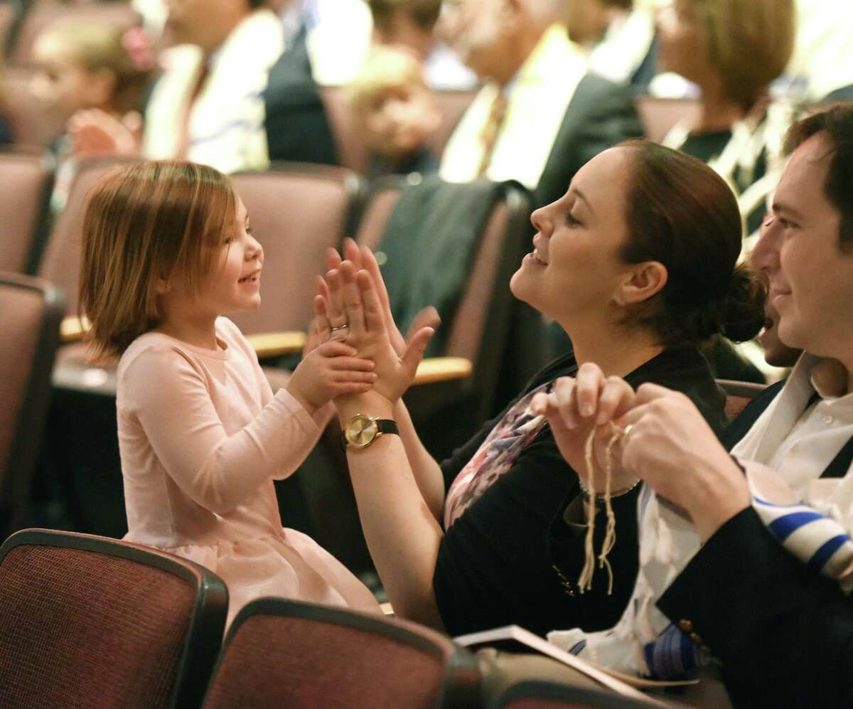 Greenwich's Ruth Moskowitz and her daughter, Hannah, 3, sing along to a song during Temple Sholom's Rosh Hashanah Family Service at Greenwich High School's Performing Arts Center in Greenwich, Conn. Monday, Sept. 10, 2018. The celebration of the Jewish New Year was highlighted by interactive musical performances from Sheldon Low and sermons by Rabbi Chaya Bender and Rabbi Mitchell M. Hurvitz.