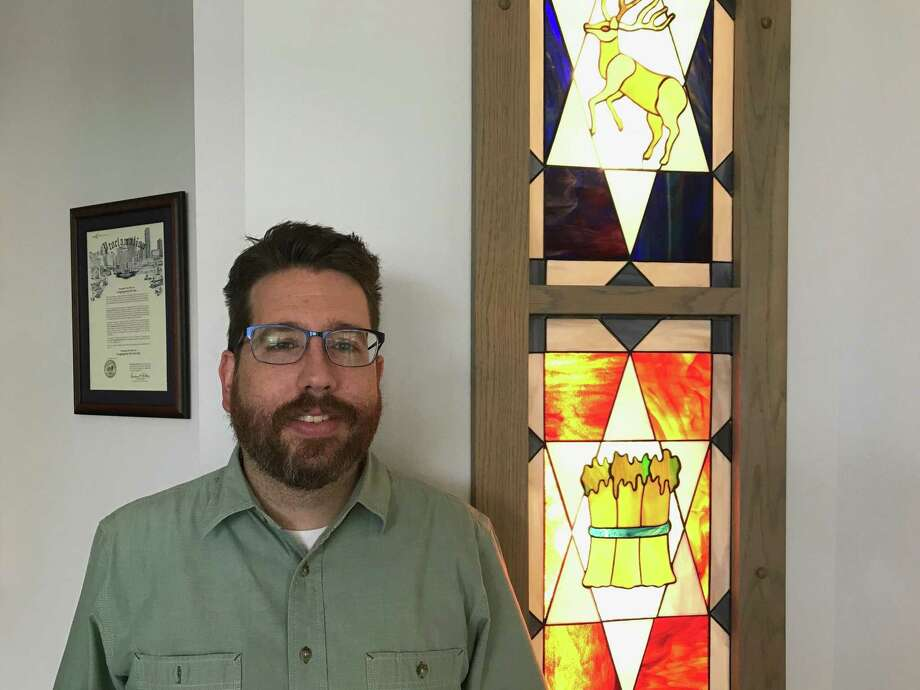 Rabbi Gideon Estes poses in front of the sanctuary doors inside Congregation Or Ami located at 3443 Wilcrest Drive. Photo: Michelle Iracheta / Staff Photo