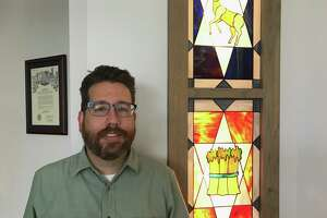 Rabbi Gideon Estes poses in front of the sanctuary doors inside Congregation Or Ami located at 3443 Wilcrest Drive.