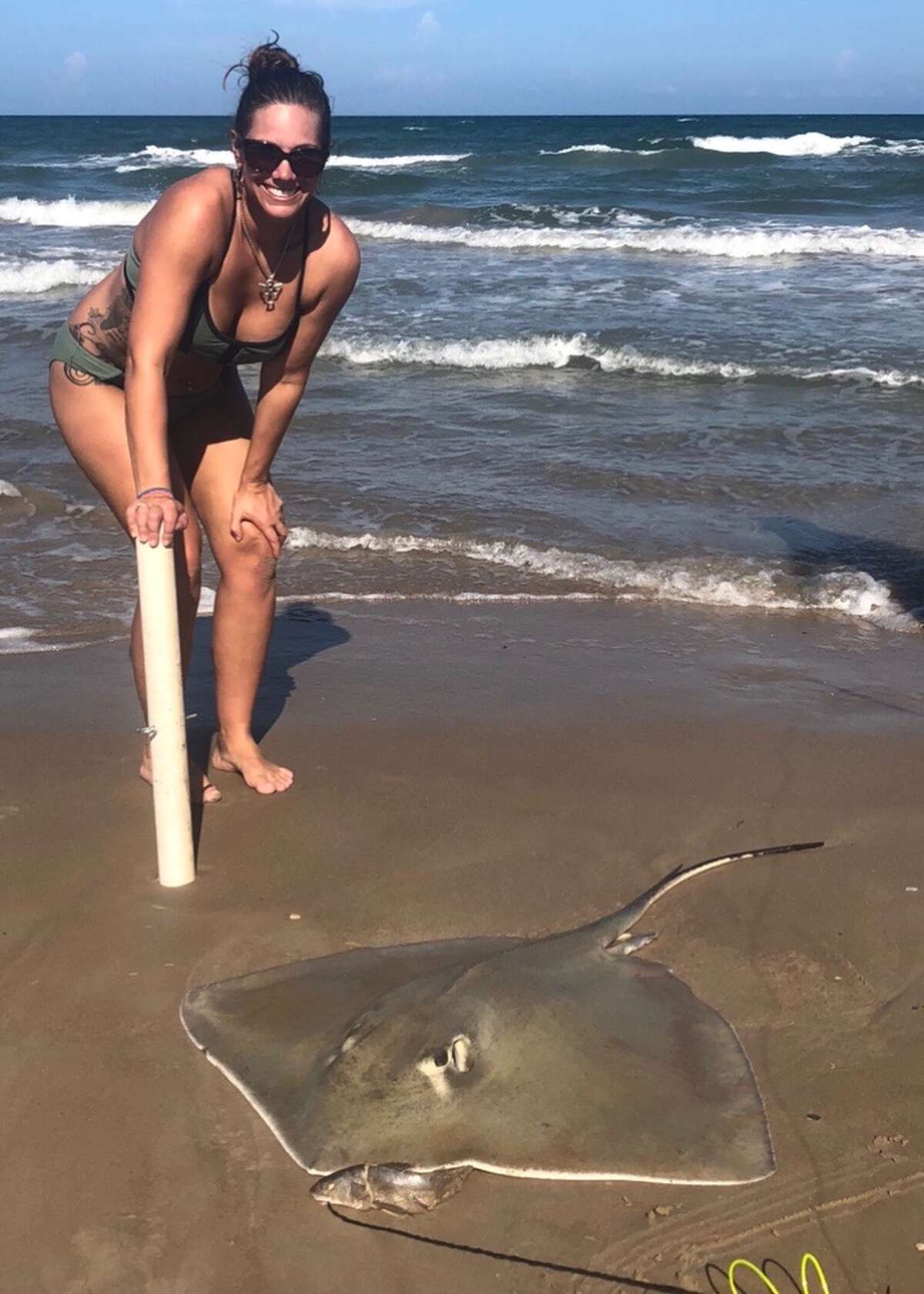 Amber Rieder, of Sinton, caught a large stingray the last weekend of August. The next weekend, she and her husband used the stingray as bait to hook two large Tiger sharks.