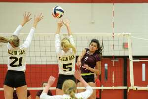 Kayla Griebl (9) of Cinco Ranch attempts a kill shot in the first set of a high school volleyball match between the Cinco Ranch Cougars and the Klein Oak Panthers during the 2018 Katy / Cy-Fair Volleyball Classic on August 11, 2018 at Katy High School, Katy, TX.