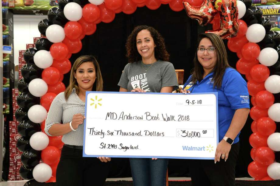 Walmart Store Manager Tonya Aguirre (Left), M.D. Anderson Representative Adelina Espat (Center) and Walmart Associate and Cancer Survivor Rebecca Romo pose with a check to celebrating the raising of $36,000 for MD Anderson Cancer Centers third annual Boot Walk to End Cancer at the Walmart Supercenter, 345 Highway 6, Sugar Land, on Sept. 5. Photo: Craig Moseley, Houston Chronicle / Staff Photographer / ©2018 Houston Chronicle