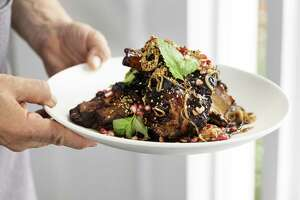 Slow-braised lamb shoulder with pomegranate and cherry glaze at One Fifth Mediterranean.