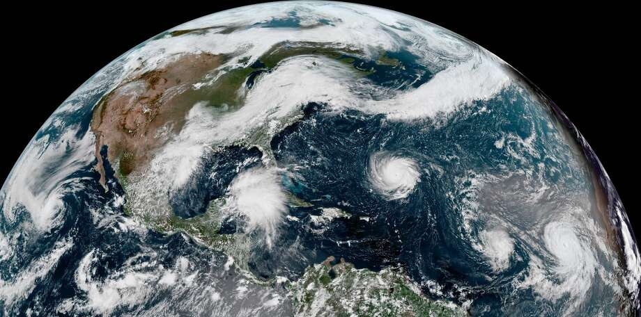 PHOTOS: Wild Texas weather This enhanced satellite image provided by NOAA shows Hurricane Florence, third from right, in the Atlantic Ocean on Sunday, Sept. 9, 2018. At right is Tropical Storm Helene, and second from right is Tropical Storm Isaac. >>>See what some of Texas' weather-setting days looked like... Photo: Associated Press