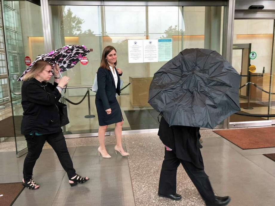From left, Joanne Pascarelli, Christine Landis, attorney for Marie Wilson and Wilson, right with black umbrella, exit the Stamford Superior Court on Sep. 10, 2018. Photo: Humberto J. Rocha / Hearst Connecticut Media / New Canaan News