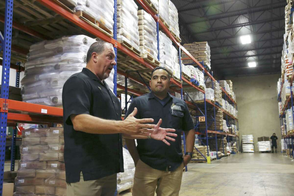 Kevin Johnson (left), CEO of Johnson Brothers Bakery Supply and Brewery Direct, and Brewery Direct Vice President Jesse R. Reyes check out their inventory. Johnson started Brewery Direct, a supplier for craft beer brewers, in 2015.