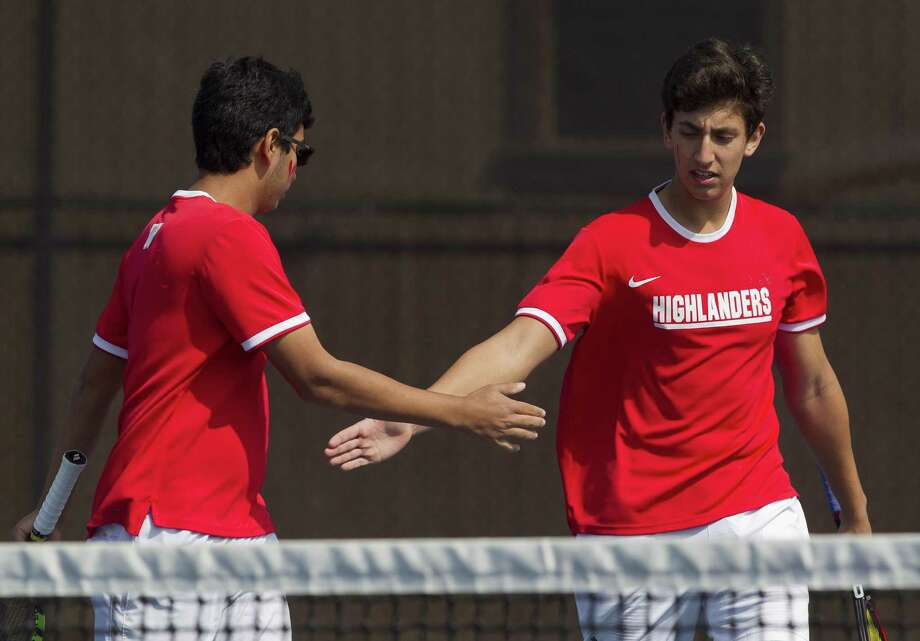 In this file photo, The Woodlands' Rock Kanzarkar, left, gets a high-five from Carlos Esteban while competing in the boys doubles finals during the District 12-6A tennis tournament at The Woodlands High School, Thursday, April 5, 2018, in The Woodlands. Photo: Jason Fochtman, Staff Photographer / Houston Chronicle / © 2018 Houston Chronicle