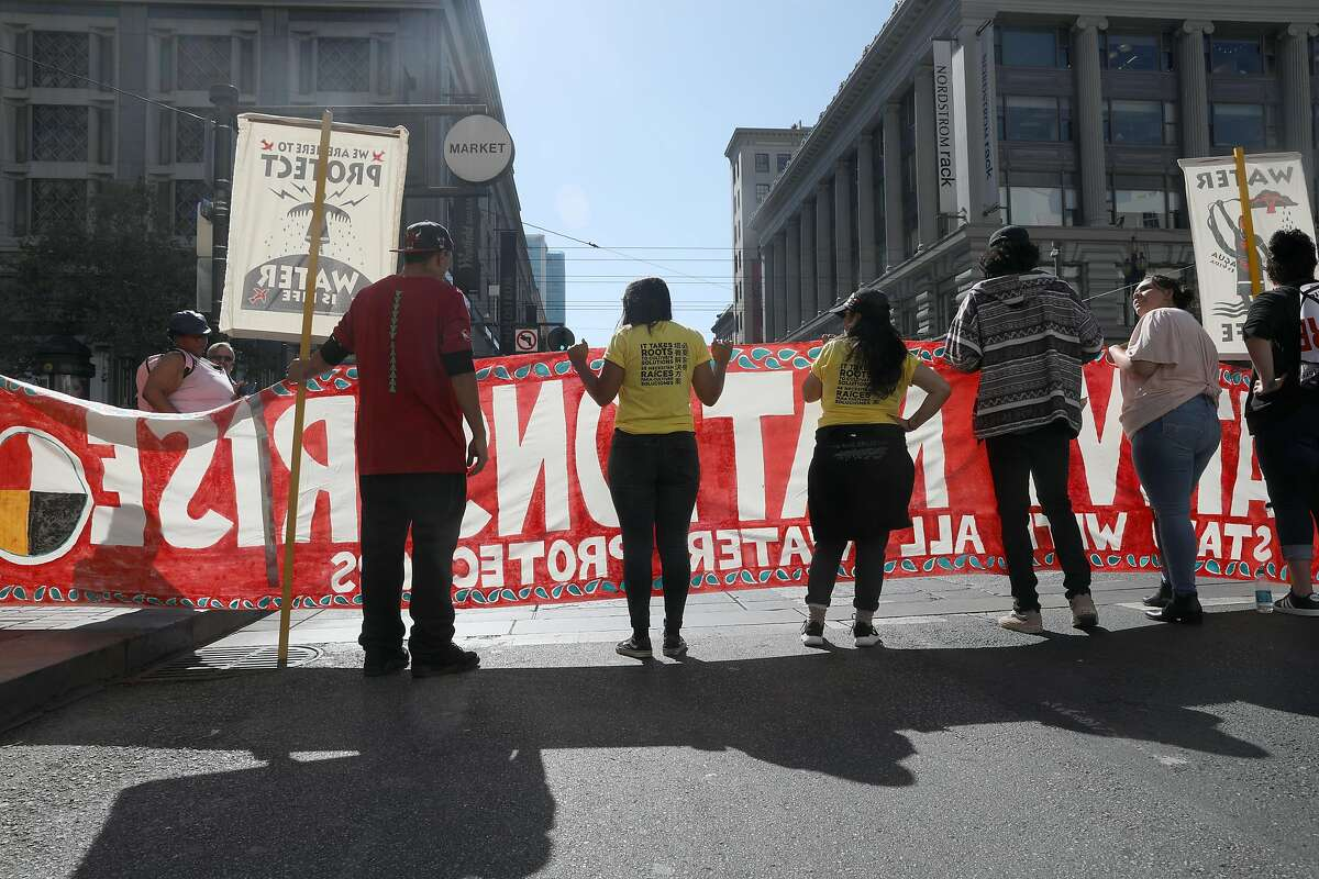 Protestors picket along Market Street at Fifth Street and Cyril Magnin Way in advance of the beginning of the Climate Summit on Monday, Sept. 10, 2018 in San Francisco, Calif.