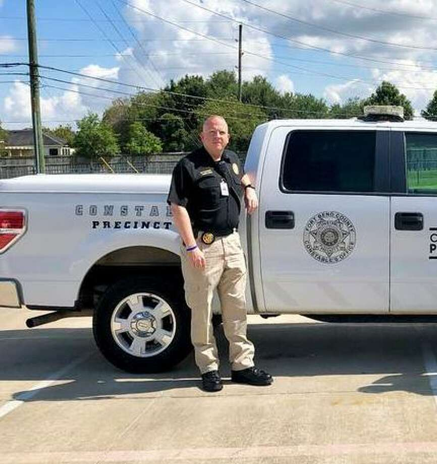 Fort Bend County Precinct 3 Constable Wayne Thompson, left, and Fort Bend County Precinct 3 Commissioner Andy Meyers implemented a pilot Motorist Assistance Program in August 2018. They expanded the program in late April. Photo: Fort Bend County Precinct 3 / Fort Bend County Precinct 3