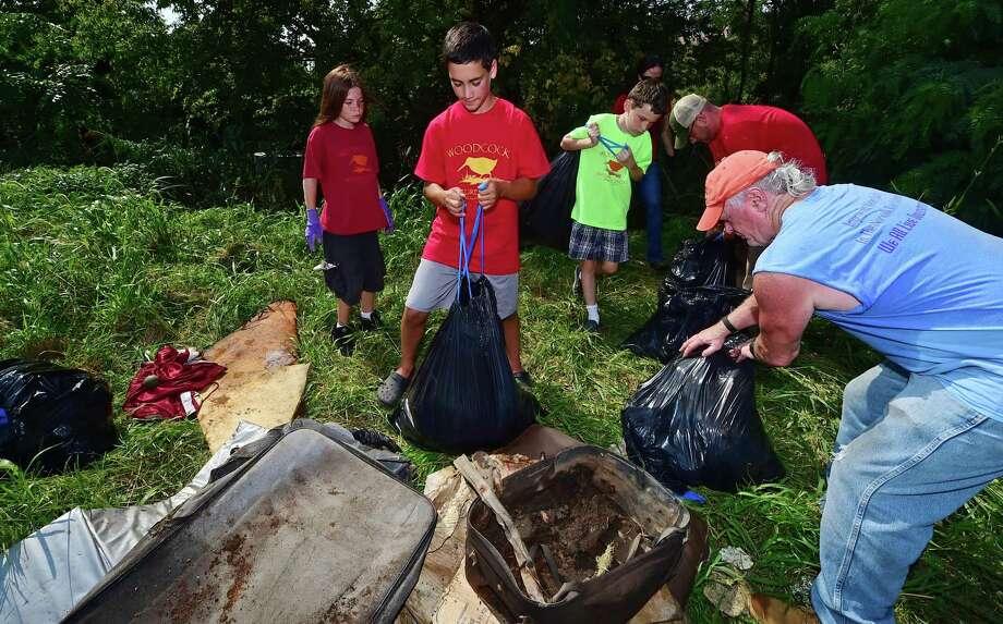 Participants in the 2016 International Coastal Cleanup, in Norwalk. Photo: Erik Trautmann / Hearst Connecticut Media / Norwalk Hour