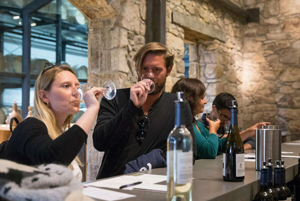Christine Weber, left, and Paul Elz of Luxembourg, Germany sip wine during a tasting at Hess Collection Winery in Napa, Calif. Tuesday, Aug. 21, 2018.