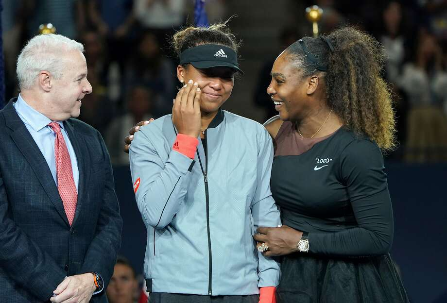 Serena Williams of the U.S. and Naomi Osaka of Japan at the trophy ceremony for the U.S. Open after Osaka defeated Williams in the final at Arthur Ashe Stadium in New York, Sept. 8, 2018. Her tirade may be long remembered and the umpire who penalized her could have acted differently, but the meltdown tarnished the sport and sportsmanship, Juliet Macur writes. (Chang W. Lee/The New York Times) Photo: CHANG W. LEE;Chang W. Lee / New York Times