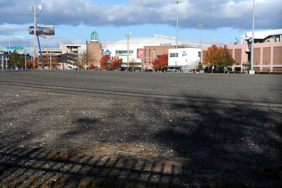 One of the two empty lots, between Lafeyette and Broad Streets, that belong to the Bridgeport Housing Authority, in Bridgeport, Conn. Nov. 14, 2014. Once the site of the Pequonnock Apartments, a public housing complex, the lots have been used for parking for the Webster Bank Arena and former Ballpark at Harbor Yard. Photo: Ned Gerard / Hearst Connecticut Media / Connecticut Post