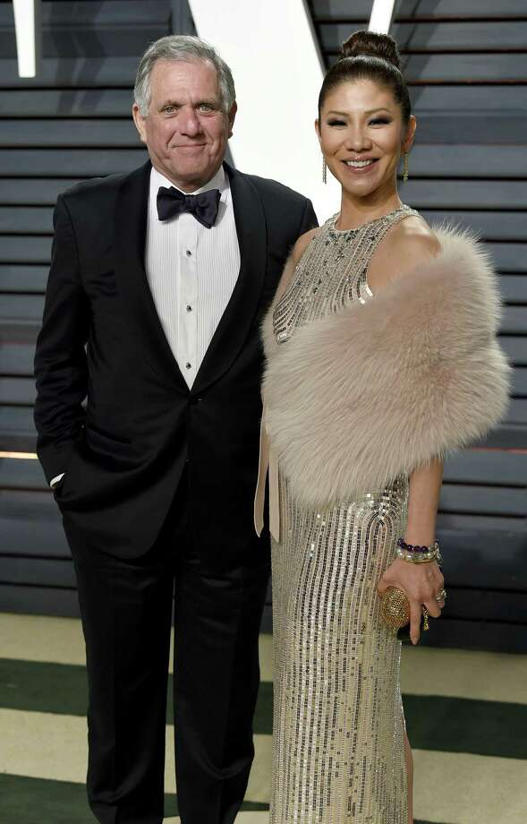 In this Feb. 26, 2017 file photo, Les Moonves, left, and Julie Chen arrive at the Vanity Fair Oscar Party in Beverly Hills, Calif. Chen was absent from her talk CBS show, The Talk a day after a new round of sexual misconduct allegations against Moonves brought the departure of the CBS chief executive. In what was supposed to be a celebratory season premiere Monday, Sept. 10, 2018, the show's four other panelists walked out somberly without Chen, who acts as host and moderator. Sharon Osbourne choked back tears as she announced Chen would be taking time off to be with her family, and expressed support for her co-star and friend. Photo: Evan Agostini /Associated Press / 2017 Invision