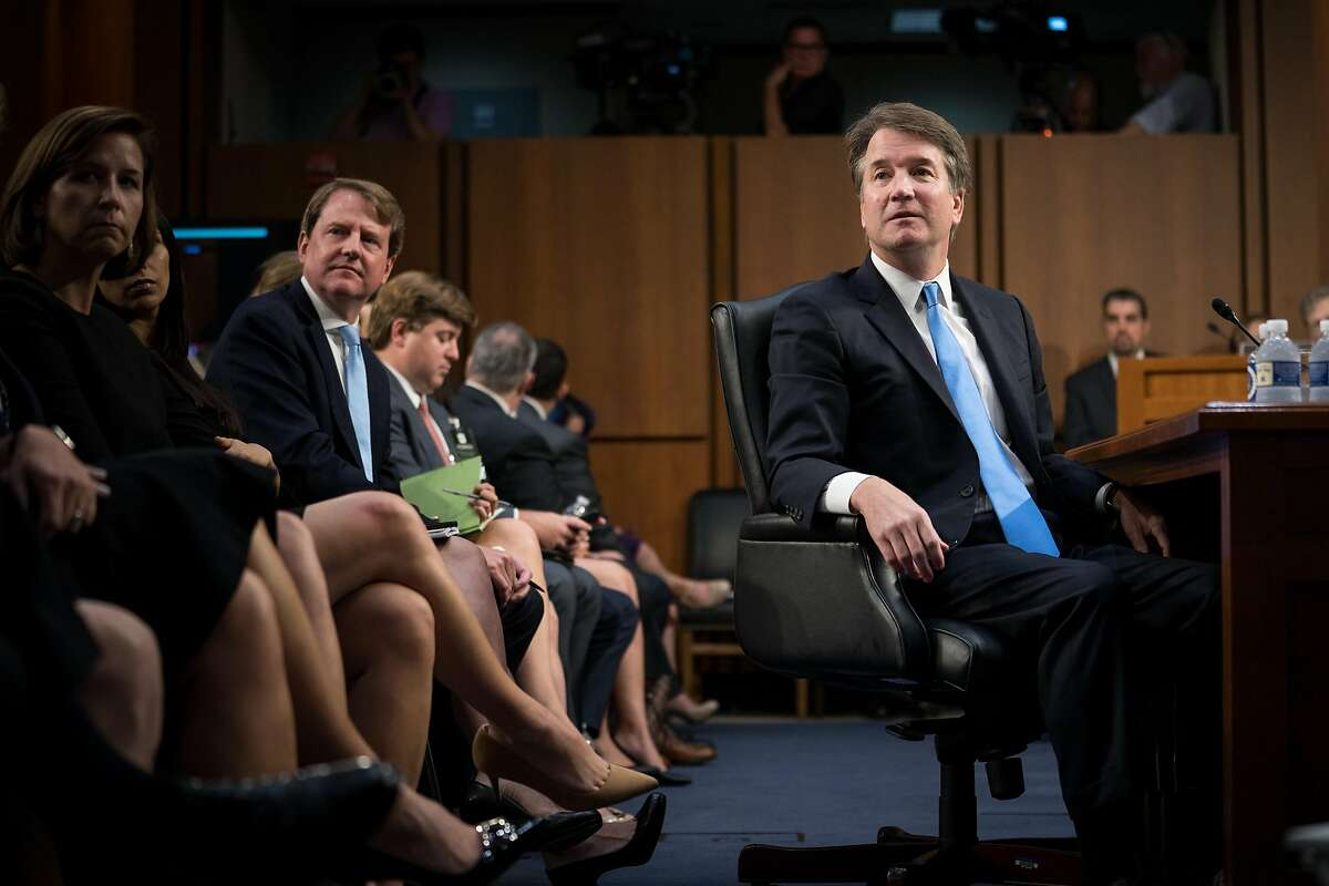 Judge Brett Kavanaugh, President Donald Trump's Supreme Court nominee, watches a video of himself during his Senate Judiciary Committee confirmation hearing, on Capitol Hill in Washington, Sept. 5, 2018. Kavanaugh studied earlier confirmation hearings carefully, as he had absorbed all of their key lessons: Say nothing, say it at great length, and then say it again. (Erin Schaff/The New York Times)