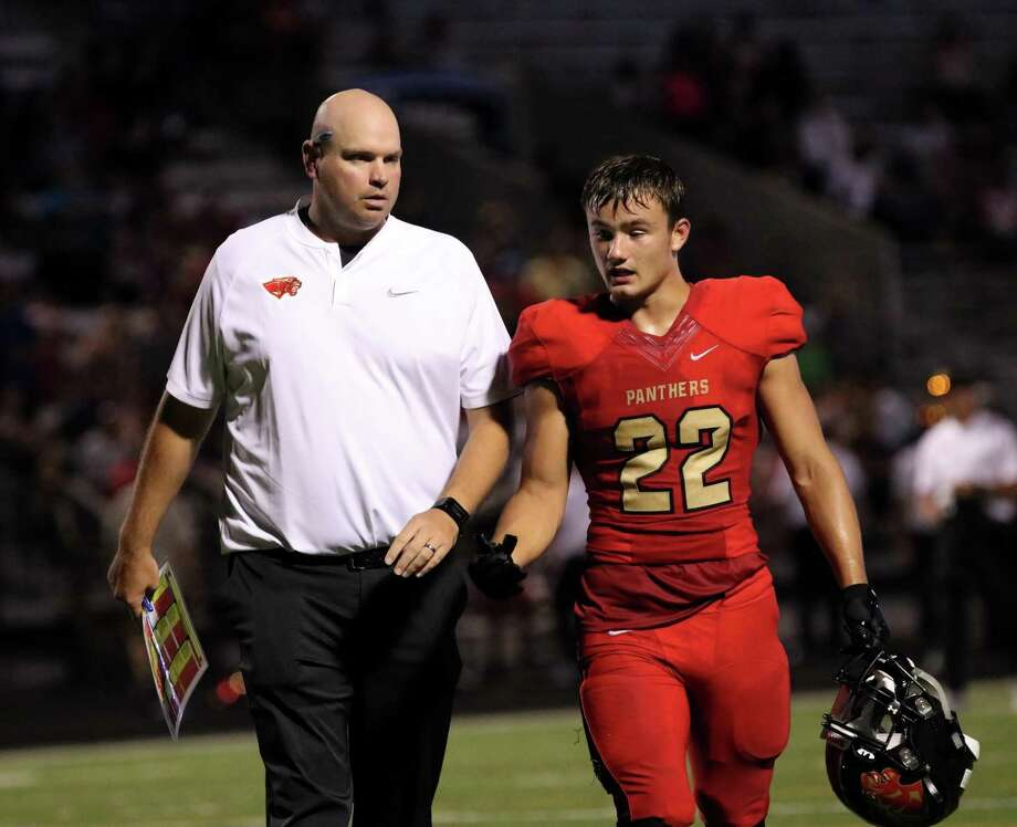 Caney Creek's Spencer Brandon (22) speaks with offensive coordinator and running backs coach Scott Merry, left, on Thursday, Sept. 6, 2018. Photo: Photo Submitted By Kelsey Alexander