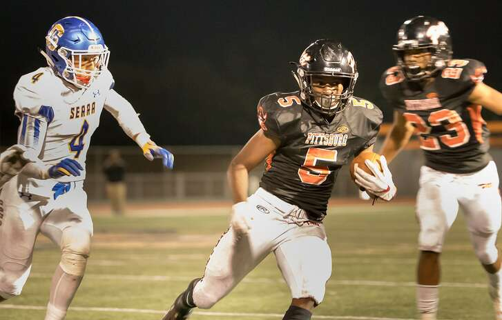 Pittsburg High School's Premier Murphy (5) runs against Serra High School's Nathaniel Sanchez (4) on Friday, Sept. 7, 2018 in Pittsburg, CA.