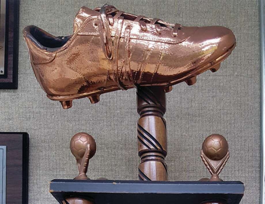 The top of the Joseph S. Carenza Bronze Boot Trophy, which sits in a trophy case at Saint Louis University. The traveling trophy was awarded to the winner of the annual men's soccer soccer game between SIUE and SLU and was last won in 1995 to SLU. The SIUE Cougars and rival Billikens will renew their series beginning Friday, Sept. 21 at SLU's Hermann Stadium. Photo: Telegraph File Photo