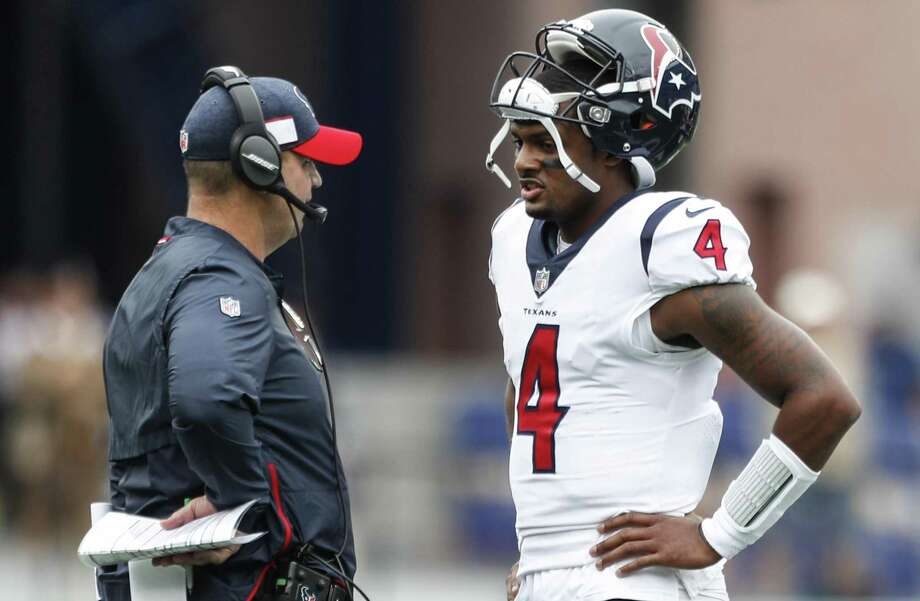 PHOTOS: A look at the Texans' loss to the Patriots on Sunday Texans coach Bill O'Brien talks to quarterback Deshaun Watson (4) during a first-quarter timeout in Sunday's opener at New England. Photos from Sunday's loss in New England ... Photo: Brett Coomer, Houston Chronicle / Staff Photographer / © 2018 Houston Chronicle