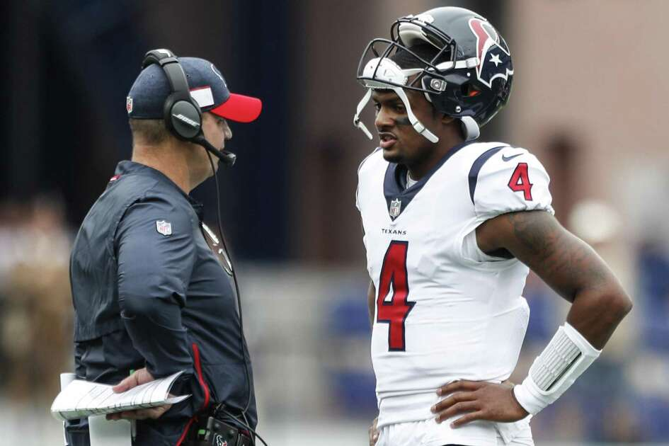 Texans coach Bill O'Brien talks to quarterback Deshaun Watson (4) during a first-quarter timeout in Sunday's opener at New England.